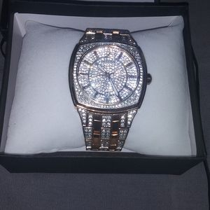 Rose gold iced out bulova